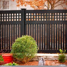 Gorgeous Black PVC Vinyl Semi-Privacy Fence with Old English Lattice and Three Inch Boards by @illusionsfence. #fenceideas #homeideas #backyardideas #fence