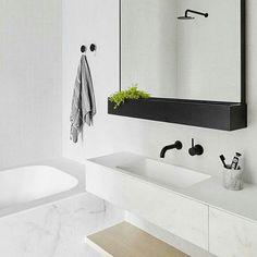 """Another shot of the beautiful bathroom we previously posted by studioyoume. White, marble, natural wood, greenery and a few black items to break up the…"""