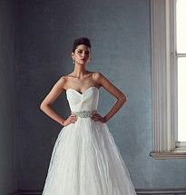 Anastasia wedding gown. Details: Sweetheart strapless gown with pleated and twist draped bodice and full skirt with pleated and top stitching detail.
