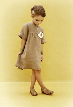 """An effortlessly elegant linen piece with a playful """"corsage,"""" from Milan-based Amelia. www.ameliamilano.it"""
