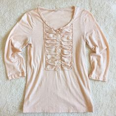 J.Crew Slub Cotton Silk-Bib Henley Soft and pretty henley with silk bib and raw edge neckline. This pale pink is the perfect neutral for your closet. Size S and tts. Style #19536. 100% cotton. ¾ sleeves. EUC with no holes or pilling. One small highlighter mark on the top left shoulder (see 3rd pic) that could probably come out with some scrubbing. Selling as is and price reflects. Please ask any and all questions. Thanks for looking! J. Crew Tops