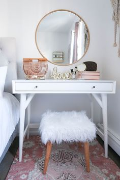 Styling A Vanity In A Small Space | White and Gold Bedroom | White and Gold Vanity | New York City Apartment | Small Apartment | DIY Vanity | Blush Bedroom | Neutral Home Decor | White and Gold Home Decor | Blush Print Rug | Faux Fur Wood Stool