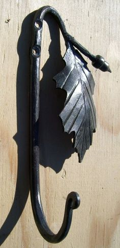 Hand forged decorative wall hook with oak leaf and acorn.  Hook is forged from mild steel.