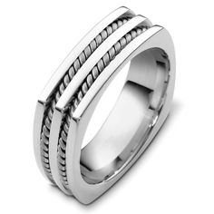 18K White gold 7.0 mm wide comfort fit wedding band. There are two hand made ropes inlayed in the band. The finish on the ring is polished. Different finishes may be selected or specified.