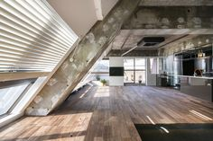 """Tokyo Loft - G Architects - Small Apartment - Living Area - Humble Homes/></p><p>To introduce light into the space they installed windows along the sloping walls of the roof. The windows provide unobstructed views over the city. From the architects: """"Since this apartment is to be used for accommodation purposes, we took the unique character of the apartment and added a hotel-like atmosphere."""" From the look of it, it's a very functional hotel.</p><p><img src="""