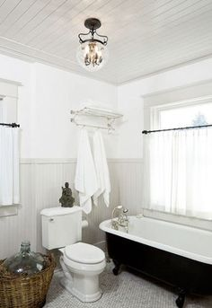 clawfoot tub.  I love the gray window casings with white walls, and painted wood ceiling.