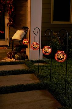 Guide eager trick-or-treaters to your doorstep with friendly pumpkin faces. Our jack-o-lanterns feature built-in LED lights that shine through crackled mercury glass to produce a haunting amber glow. Balsam Hill, Pathway Lighting, Pathways, Solar Power, Pumpkin Faces, Halloween Season, Lights, Mercury Glass, Halloween Decorations