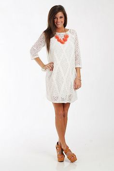 "Floral Lace Dress, White $67.00 Nothing says summer quite like a white lace dress, and this is one of our favorites! The lace has a very delicate feel to it, and we love the diamond grid detail on the body of the dress. This one does come with a slip, so all you need are accessories!   Fits true to size. Miranda is wearing a small.   From shoulder to hem:  Small - 33.5""  Medium - 34""  Large - 34.5"""