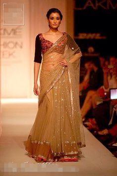 Golden Net lehnga by Manish Malhotra ..
