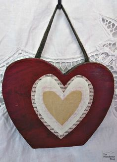 hanging decoupaged wooden heart, what the heart hides - theboondocksblog.com