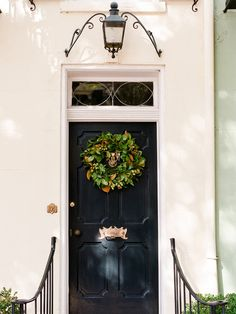 Savannah doorway with magnolia wreath and brass letter slot by Allison Mannella   Historic Homes in Savannah