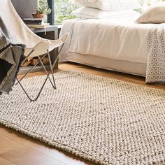 A neutral floor covering, like a jute or wool area rug, ties everything together. Without it, the room would feel incomplete.