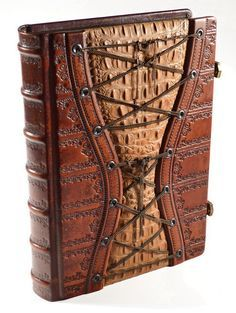 Sumptuous baroque hand made leather journal. An exquisitely rich detailed embossed book for your thoughts… Hand tinted leather creating an unique color gradient. The center of the front cover presents alligator texture within patina brass chains....