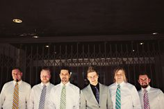 photo by Seattle wedding photographer Sean Flanigan - groomsmen in multi-colored striped ties