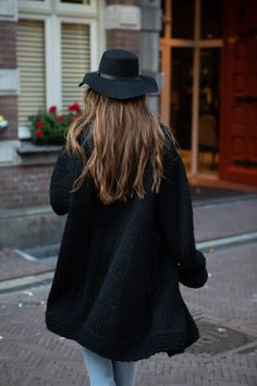 Neo fashion casual black coat hand-knit in pure lambswool with a horizontal collar. Two pockets on the sides. For the perfekt autumn stylish coat outfit. By Mihaela Markovic ladies brand #fashiondiscovery #Mihaela_Markovic #Sweater #fashion #style  #coats_jackets #autumn_coat #jacket_coat #long_coat #coat_for_fall #coat_outfit #coat_style #casual_coat #designer_coat #coat_fashion #black_coats #womens_fall_coat #ladies_coat #fashion_coat #black_coat_outfits #womens_casual_coat #handknit_coat