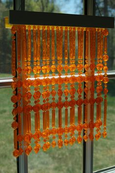 Vintage bead curtain.  My grandparents had a similar (in different colors) curtain hanging as a divider in their master bath/bed room