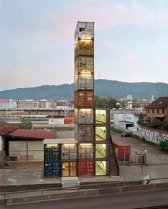 "Famous recycle-material bag maker, ""Freitag"" Shop in Zurich. Their flag shop is also made out of recycle containers stacking up to 85ft!"