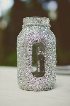 Table number idea! Cute! Could do this on simple vases for a non-rustic wedding, and create a simple centerpiece with a flower arrangement too!
