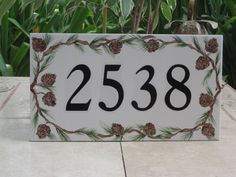 Hand painted- perfect for a cozy cabin Tile House Numbers, Address Plaque, Pine Needles, Cozy Cabin, Porcelain Tile, Pine Cones, Tiles, Mosaic, Hand Painted
