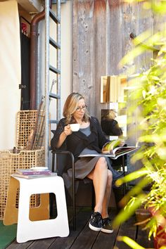 """Small space living: """"Embrace the lifestyle you imagine you would have in your dream city. Have a tiny balcony? That's just the right size for sitting with your espresso and perusing the new gallery listings!"""""""
