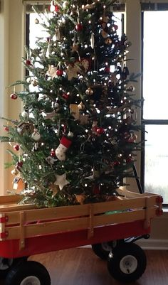Christmas Tree for Small Spaces and Away from Small Hands  We placed our tree in our 17 month old's red wagon.