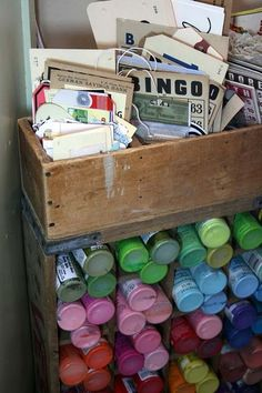 A clever way to organize paint. Also, pics of the most amazing craft room I have ever seen. I need one.
