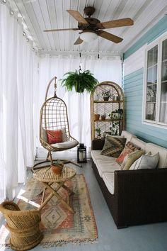 a small boho sunroom with a dark sofa, wicker furniture and a hanging chair plus… - Home Decoration Sunroom Decorating, Interior Decorating, Interior Design, Sunroom Ideas, Patio Ideas, Enclosed Porch Decorating, Interior Work, Porch Ideas, Sunroom Diy