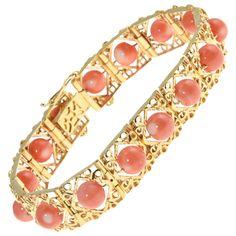 1970s Highly Stylized Coral Gold Link Bracelet | From a unique collection of vintage link bracelets at https://www.1stdibs.com/jewelry/bracelets/link-bracelets/