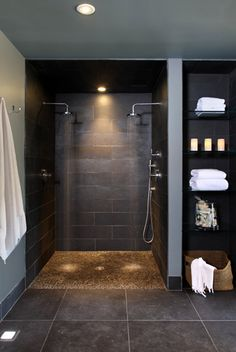 black luxury bathroom with two showers For more please visit: http://www.flyfreshforever.com