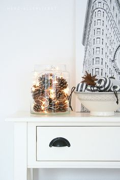 pine cones and white christmas lights - must do this in my giant bell jar Christmas Mood, Noel Christmas, All Things Christmas, Christmas Lights, Holiday Lights, Navidad Diy, Diy Weihnachten, Xmas Decorations, Christmas Inspiration