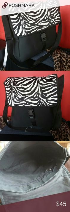 Zebra shoulder/laptop bag Super chic Zebra print shoulder/laptop bag. Pictures as is. Secure buckle in front. Bag made by Jordan accessories NYC Jordan accessories NYC Bags Laptop Bags