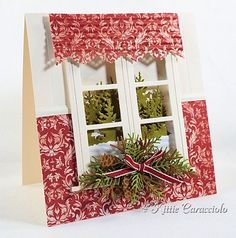 window card by Kittie Caracciolo.... inside looking out on to a snowy landscape of evergreens.... with curtain and wallpaper!