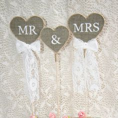 Mr & Mrs wedding cake topper. The burlap hearts are hand cut and framed with…