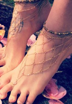 This gold chain mesh barefoot sandals is styled with mesh chains, lobster locks and rhinestones. Acquire it here. | Lookbook Store