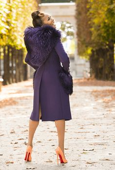 Marjorie Harvey is wearing a Dolce & Gabbana Fall/ Winter 2014 runway hooded coat and Christian Louboutin Pigalle Pumps.