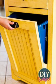 Free DIY Storage Project Plan: Learn How to Build a Tilt-Out Hidden Trash Can Seriously I need three of these! for ugly trash can 2 & 3 for laundry hampers Laundry Storage, Laundry Room Organization, Laundry Hamper, Food Storage, Organizing, Garbage Storage, Laundry Bin, Laundry Sorter, Laundry Rooms