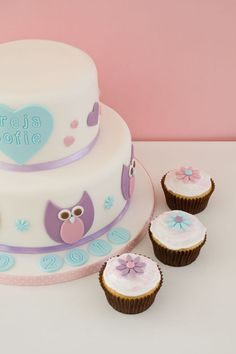 Christening cake with owls and cupcakes