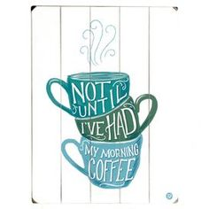 """The perfect addition to your kitchen or breakfast nook, this planked wood wall decor showcases a stacked coffee cup motif and typographic detail.    Product: Wall decorConstruction Material: WoodFeatures: Ready to hangSawtooth hangers includedDimensions: 16"""" H x 12"""" W Cleaning and Care: Wipe with a damp cloth"""
