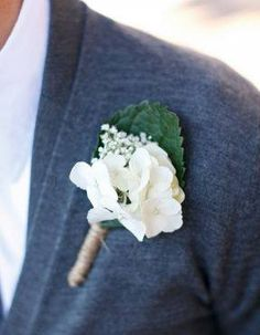 Boutonniere: Silk white hydrangea blossoms, fresh babies breath, silk hydrangea leaf wrapped in twine.