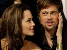Angelina Jolie, and Brad Pitt sit together before the start of the 14th Annual…