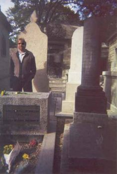 I have a different view of this picture posted on this board, but this view shows more of the grave site. Tom Petty snapped this picture of Jim Morrison's grave site, which shows his image in the background. Considered an authentic ghost photo.