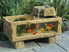 Rustic aquarium with waterfall.  Love this!