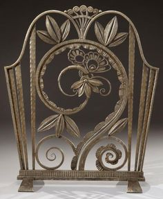 "KISS PAUL (1895-1962)    Firewall hammered wrought iron openwork and animated flowers, foliage and windings. Hollow stamped ""Paris Paul Kiss."" To 1925."