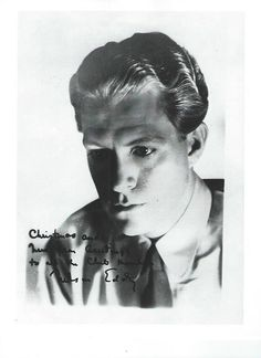 """Found this in a scrapbook I bought from a fan: a younger Nelson, quite thin and pensive with the ff: written on it:"""" Christmas and New Year Greetings to all the Club Members, Nelson Eddy.""""-ESCANO COLLECTION"""