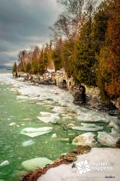 Late Winter At Cave Point by Shutter Happens Photography. Lake Michigan is a slurry of slush and ice on a late winter afternoon at Cave Point County Park near Whitefish Bay on Wisconsins picturesque Door County peninsula.