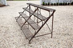 Plant Stand Arras Plant Stand France circa 1930 A rare Arras wrought-iron, four-shelf plant stand.Arras Plant Stand France circa 1930 A rare Arras wrought-iron, four-shelf plant stand. Plant Shelves Outdoor, Garden Shelves, Metal Plant Stand, Plant Stands, Garden Center Displays, Succulent Landscaping, Brick Fence, Greenhouse Plans, Flower Stands