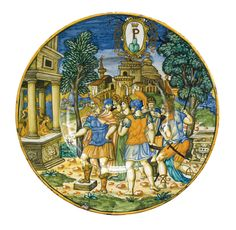 An Urbino maiolica dish, painted with Aeneas honouring his father's tomb, a town in the background, 1549
