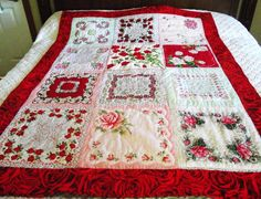 Rose quilt made from vintage hankies with roses.  The border fabric is red roses.  Stunning!