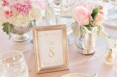Gold framed table numbers.
