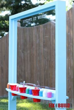 DIY Kids Outdoor Acrylic Easel - Give your little artist a place to use their creativity with this fun DIY project.